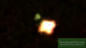Green orb pulls larger mass in UFO video by Charles Lamoureux